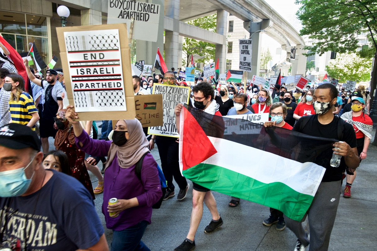 Seattle demonstrators crowded Westlake Park and surrounding streets May 15, marking not only 73 years since the initial displacement of Palestinians by the Israeli state but also the recent surge of violence in Gaza. Photo by Al Stern