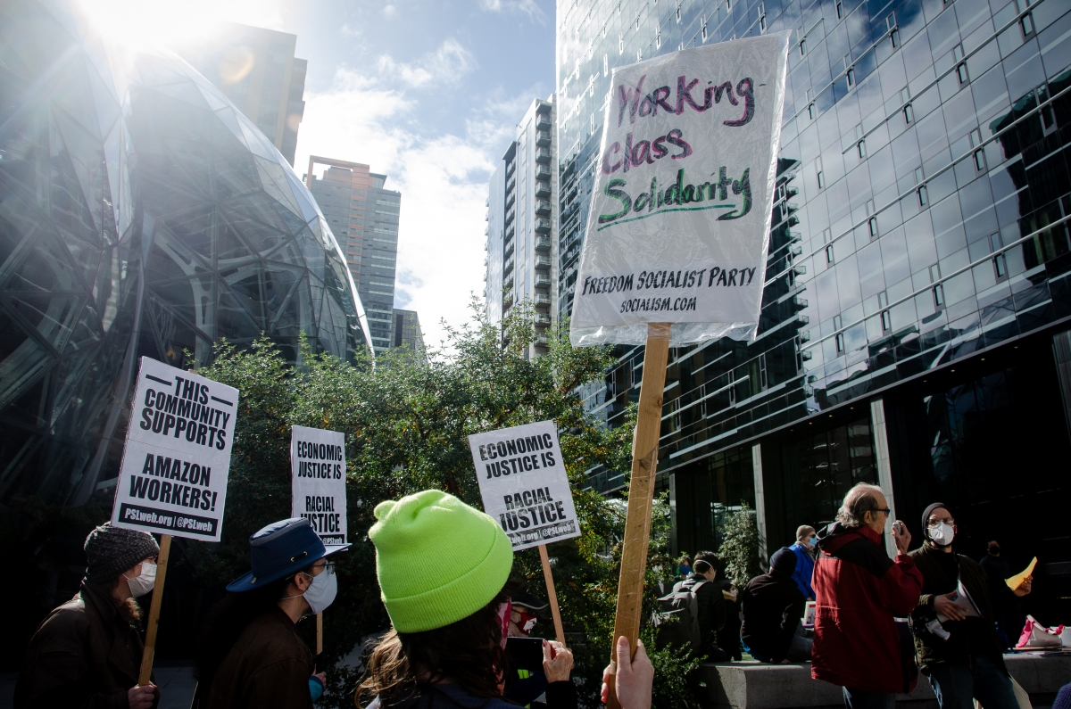 A crowd gathers outside the Amazon Spheres in South Lake Union, March 20, to support the unionization efforts of Amazon warehouse workers in Bessemer, Alabama. Photo by Christy Carley