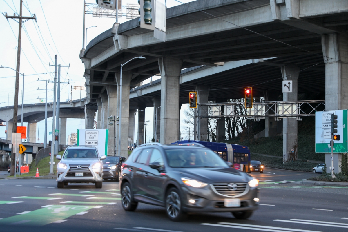 Cars going onto the West Seattle low bridge. The traffic information billboards show the pre-expanded access hours. Residents can now drive on the bridge during the weekends from 5 to 8 a.m. Photo by Samira George