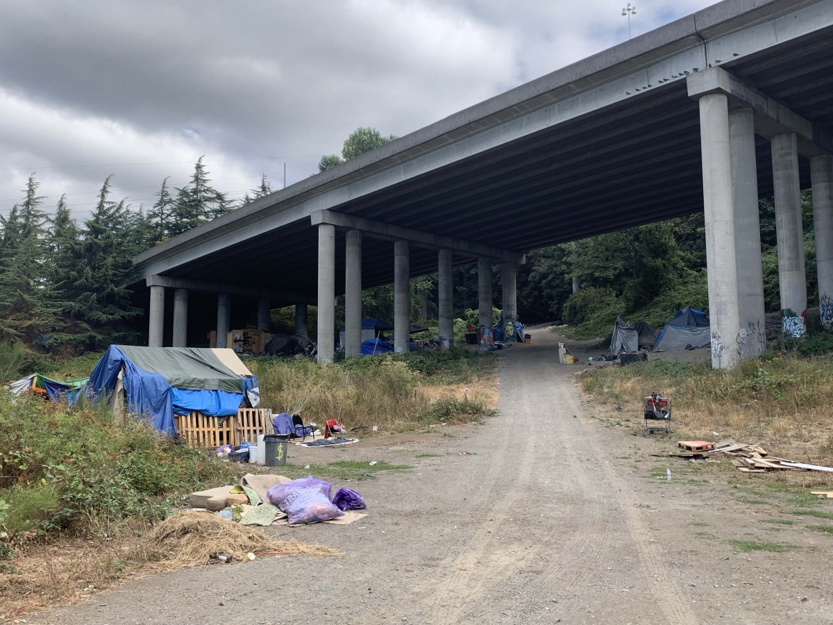 Someone living at the Snoqualmie Hill encampment was treated for COVID-related pneumonia at Swedish Hospital earlier in September. The overall consensus at the Georgetown homeless camp is that residents are generally not seeking vaccinations. Photo by Han