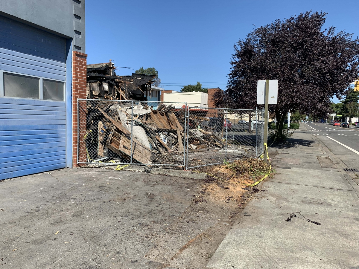 Only rubble remains Sept. 2 of a vacant commercial building in White Center that allegedly provided shelter to several people that was destroyed by a Sept. 1 fire. In October 2019, the building was the scene of an arson. Photo by Hannah Krieg