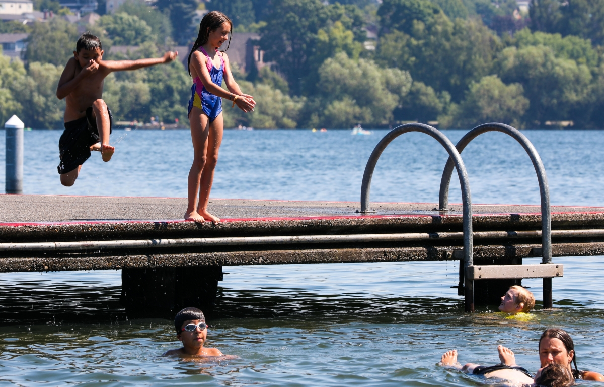 Children play in north Seattle's Green Lake during record-breaking heat on the afternoon of Monday, June 28. Photos by Samira George