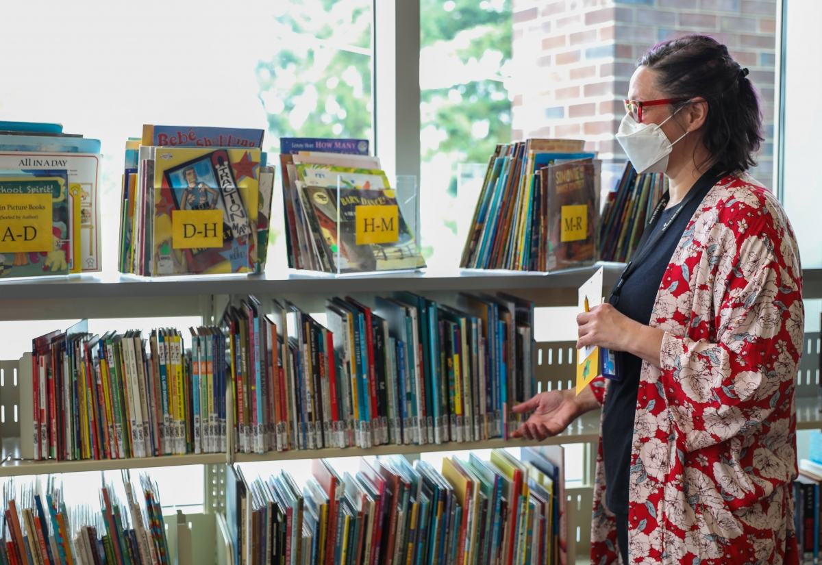 """Greenwood Library teen services librarian Jennifer Bisson finds libraries are a unique space in the community. """"There're not a lot of places in the world left that you can just kind of scan and borrow and not have to think about the cost of it,"""" she said."""