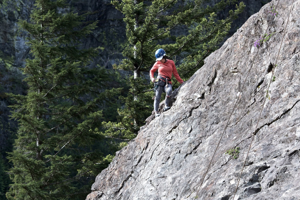 As the weather warms, North Bend's cliffs fill with climbers of all skill levels; a climber pauses halfway up one of the many climbs in Deception Crags, May 30. Photos by Samira George and Al Stern