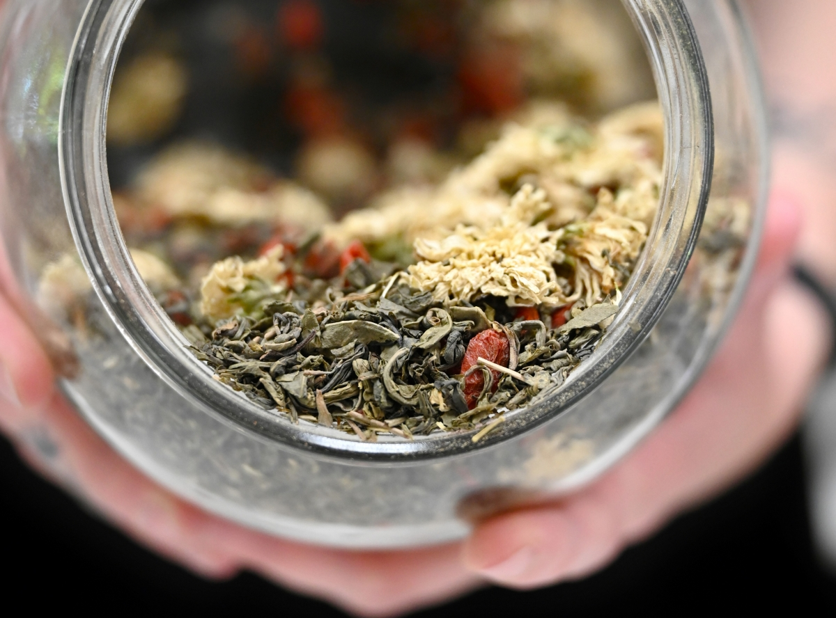 Friday Elliott of Friday Afternoon Tea presents one of her tea blends. Photos by Ace Azul