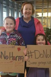 Cecelia Linsley, center, and her daughters Chiara, left, and Thea attended a charged City Council meeting to support the rights of their neighbors homelessness.