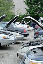 A row of cars up for sale at the Lincoln Towing auction site in June. Photo by Monica Westlake