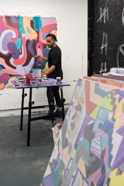 Johnson's work has appeared in nearly 50 gallery shows. He often uses purple paint in his work. Photo by Alex Bergstrom