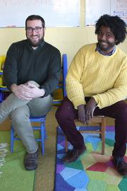 The founders of Columbia City Preschool of Arts and Culture, Benjamin Gore, left, and Jasen Frelot, sit in their preschool located in the Columbia City Church of Hope. Photo by Jon Williams, Real Change