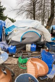 "In March, Seattle police and outreach workers cleared ""The Field of Dreams"" encampment located where South Royal Brougham Way meets Airport Way South near Interstate 90 in SoDo. File photo by Matthew S. Browning"