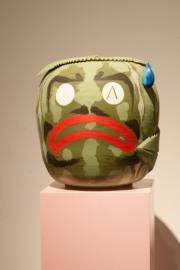 """""""Anxious Watermelon"""" by Alex Anderson, stoneware, glaze and gold luster on wood pedestal, 15x12x14. Photo by Walter Tuai"""