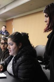 UW MEChA members Maria Martinez, Marilyn Sanchez Martinez and Gema Soto-Marquez look over a grant during one of the Monday meetings. Photo by Blake Peterson