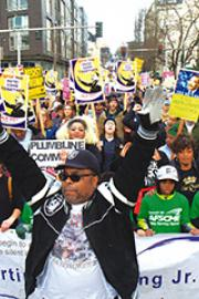 Thousands follow parade leaders from Garfield High to the Federal Building. Photo by Wes Sauer