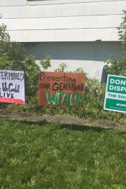 Signs posted on the front lawn of Reagan Jackson's Rainier Beach home. Photo by Reagan Jackson