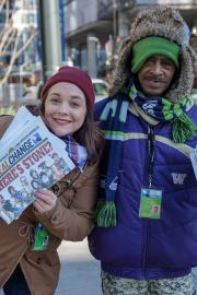 Columnist Hanna Brooks Olsen and vendor Yemane Berhe sell copies of Real Change. Photo by Jeff Few
