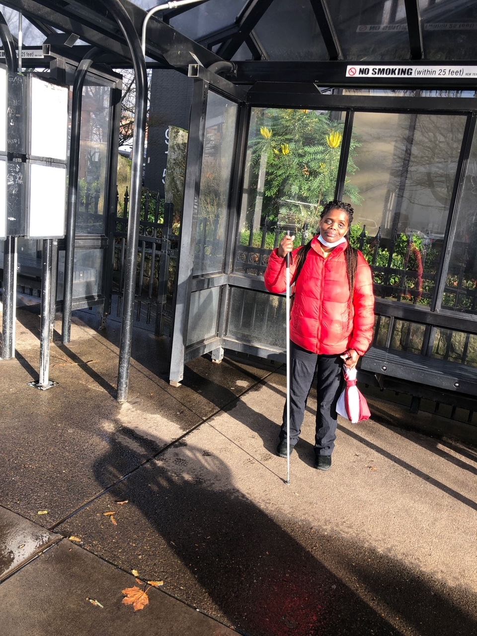 As a transit advocate, Griffith, shown at a bus stop, is drawing attention to areas that Washington policy and lawmakers have neglected. Photo courtesy of Abby Griffith