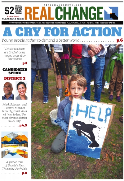 Owen Bellmore, 6, a student at Gregory Heights Elementary School in Burien listens to the youth speakers at Cal Anderson Park before marching with his dad and brother to Seattle City Hall during the Climate Strike on Sept. 20. Photo by Susan Fried.