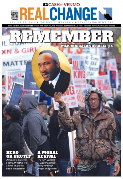 Darrell Odoms holds a portrait of Martin Luther King Jr. during the annual march and rally Jan. 20. There's a story and more photos beginning on page 6. (Photo by Jon Williams).