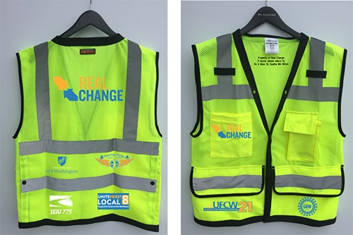 High visibility vest for Real Change vendors are now wearing.
