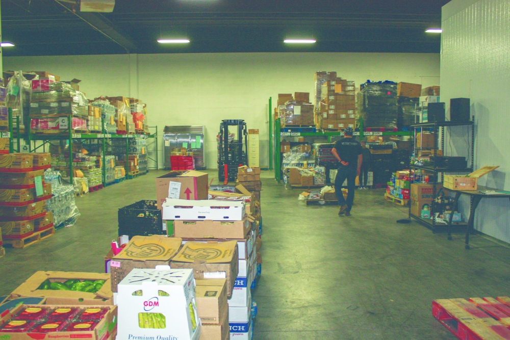 Volunteers for We Don't Waste work among its food stock to ready the products for pantries around Denver. Photo courtesy of We Don't Waste