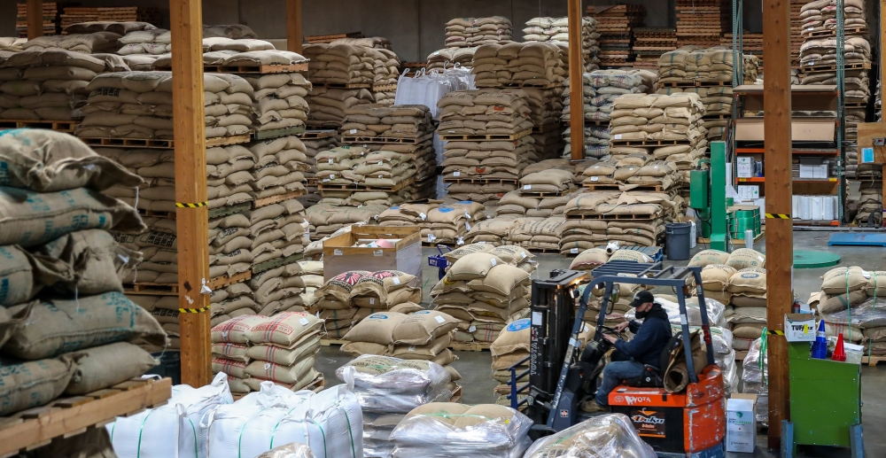 222,000 bags of coffee beans from 32 different countries rest inside the warehouse, waiting to be shipped out to coffee roasters across the country. Ethiopia, Brazil and South Africa are some of the origins of the beans.