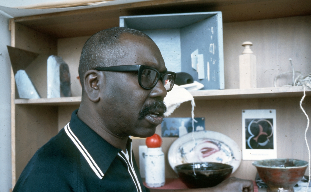 Jacob Lawrence in his studio, 1972. Taken while he was working on the George Bush series of paintings. Collection of Washington State Historical Society, C1973.27.7.4.