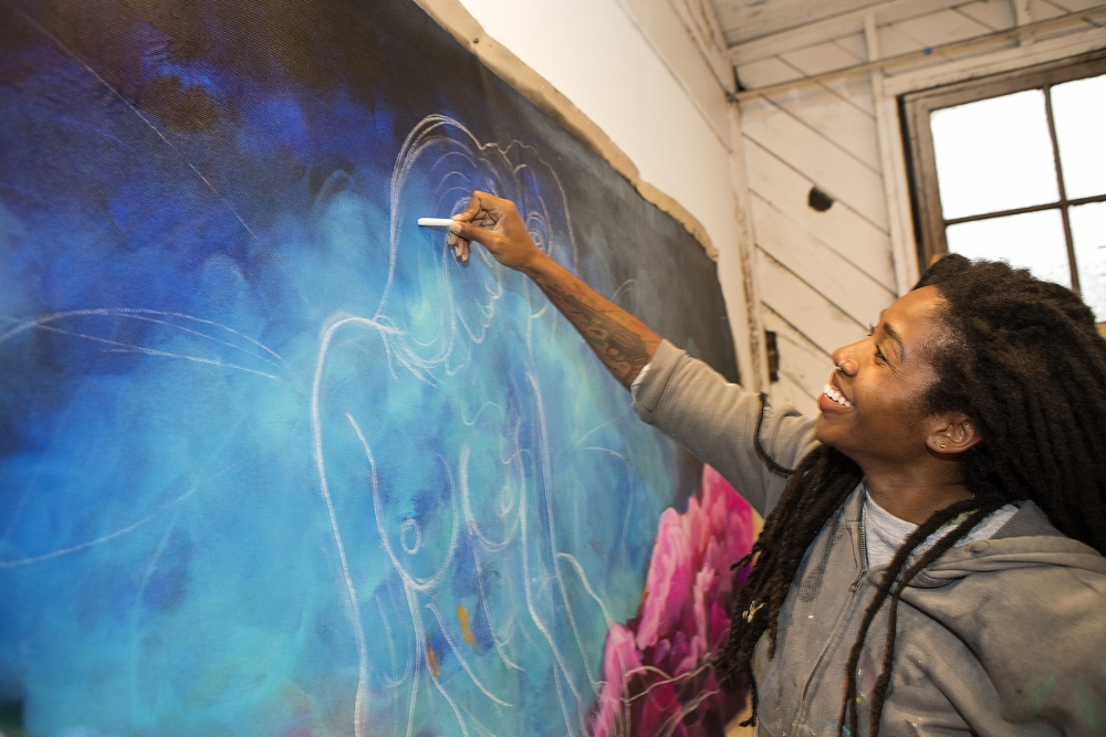 "Hamer works on ""Gemini"" in her Ballard studio. Photo by Joseph Romain"