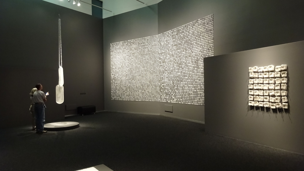 "(left and center) ""To Those Who Have"" and ""Every Year"" by Jeffrey Stenbom. (far right) ""Promises and Lies: Keeping Score"" by Cheryl Wilson-Smith. Photo by Lisa Edge"