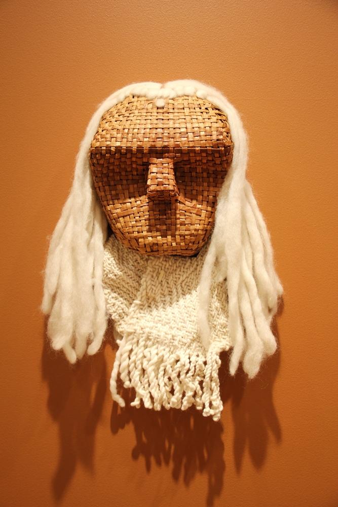 """""""Eldar"""" by Peg Deam, woven red cedar, wool hair and woven wool blanket with deer bone blanket pin, 2001"""