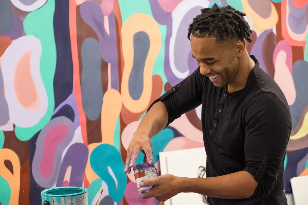 While his artwork is serious, Barry Johnson says he's having fun creating several pieces at a time.