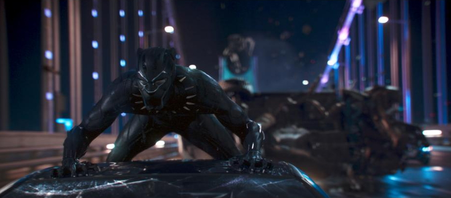 Black Panther on top of a car in one of the movies fast paced fight scenes. Photo courtesy Disney