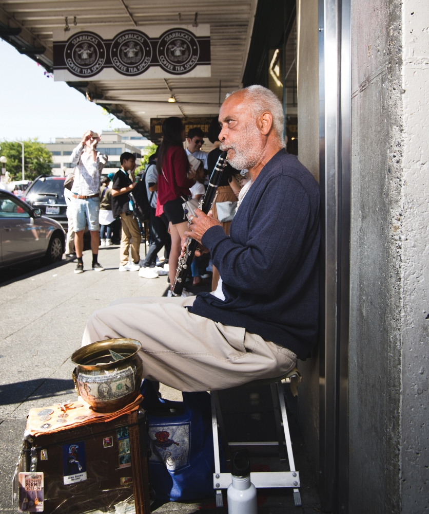 Michael Bell plays his clarinet at the market. Photo by Matthew S. Browning