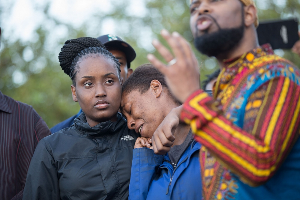 Charleena Lyles' family mourns with a crowd at her home in Sand Point about the June 18 shooting. Photo by Alex Garland