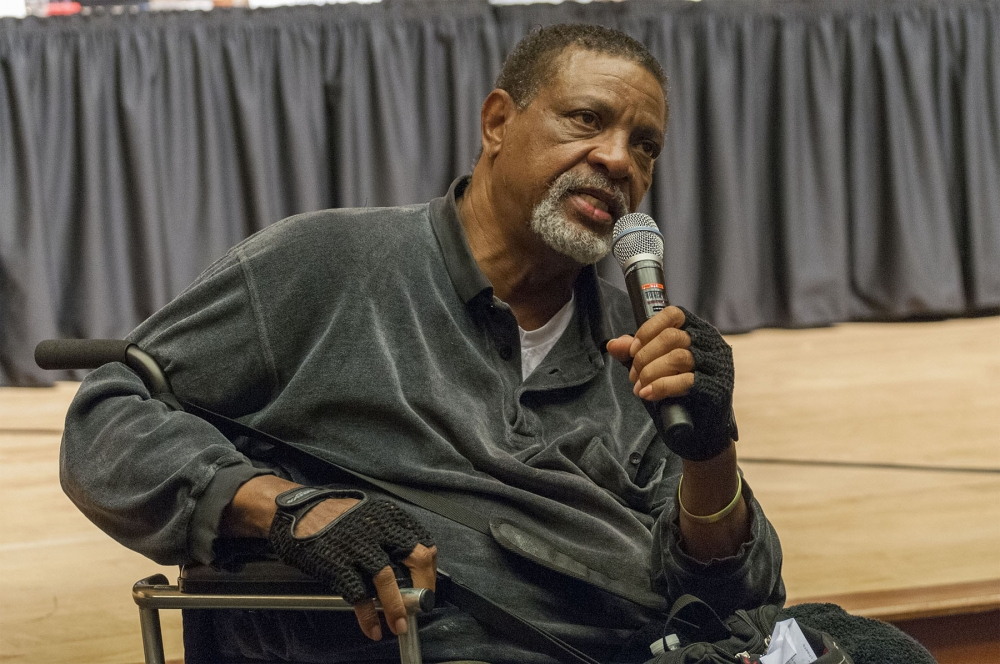 Charles Lyles, Charleena Lyles' father, speaks at Kane Hall at UW about the fatal police shooting. Photo by Monica Westlake