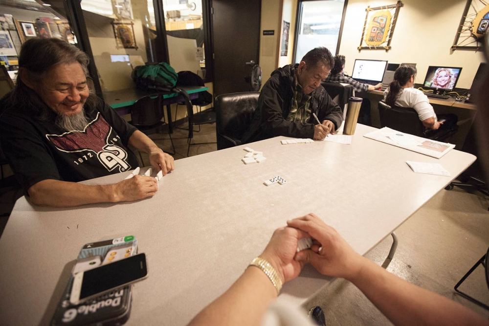 The Chief Seattle Club provides food, medical support, housing assistance, computer training, legal services and as a place to talk and play dominoes for many of the city's homeless Native Americans. Photo by Ngoc Tran