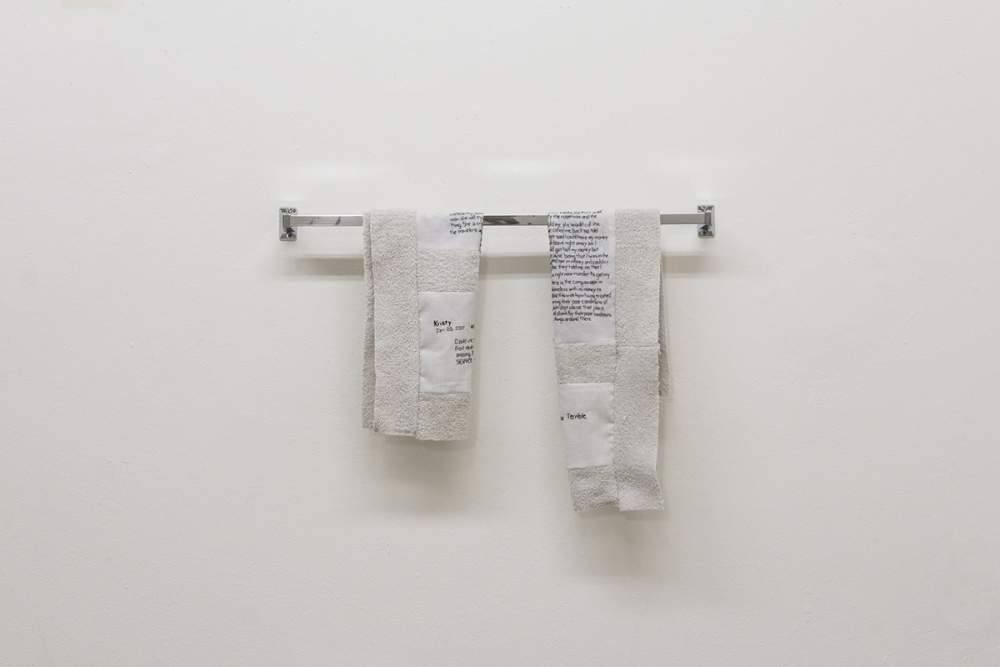"""Feel Just Like Home"" by Cicelia Ross-Gotta, 2019. Internet reviews of the motel where a family member has lived since 2016, used bed linens and towels, embroidery floss, and towel racks. Photo: Ruth Kazmerzak"