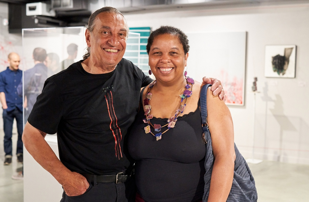 Warren Pope, left, with a visitor to his NAAM exhibition. Photo by Michael B. Maine