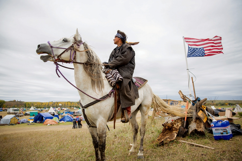 Frank provides security for the main camp called Oceti Sakowin, on the Standing Rock Indian Reservation. Photo by Alex Garland