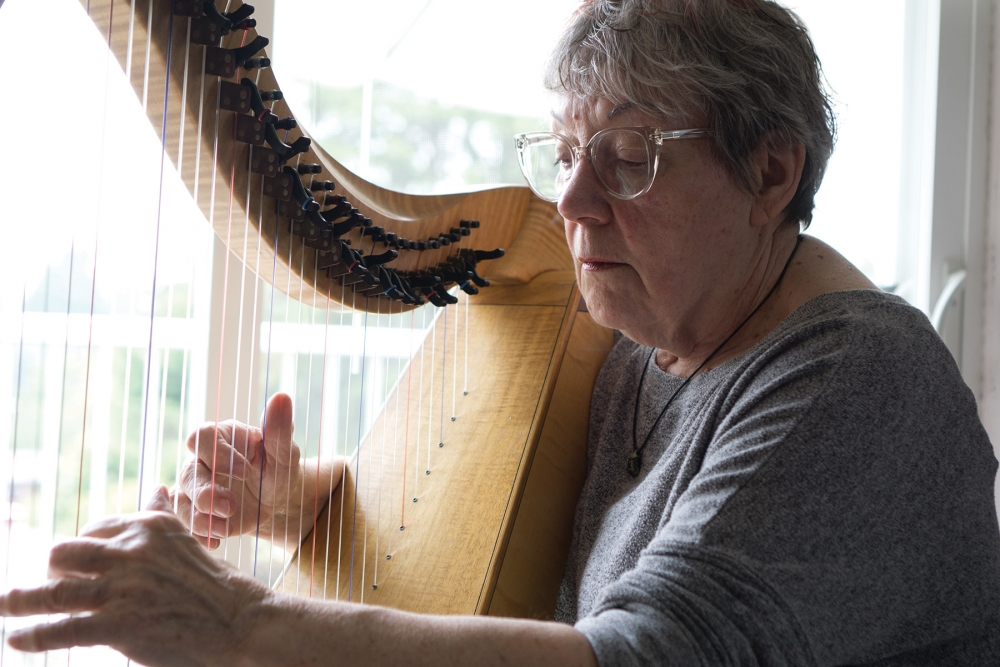 Sile Harriss, a music-thanatologist by training, played harp for the dying and their families for nearly 20 years. Photo by Wes Sauer