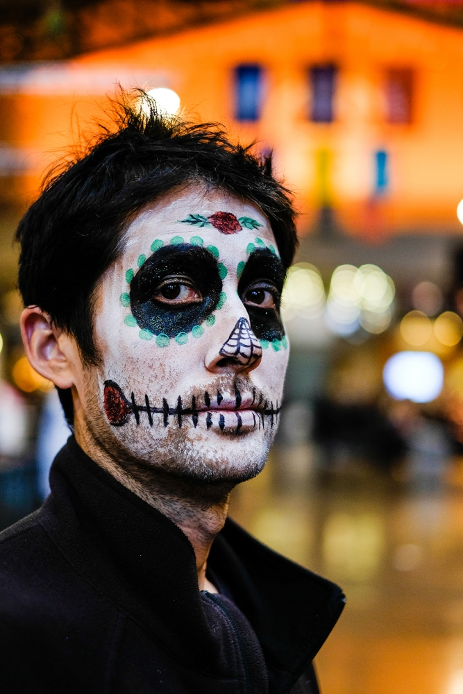 Manny Lewis wears traditional Día de los Muertos face paint. Photo by Alex Bergstrom