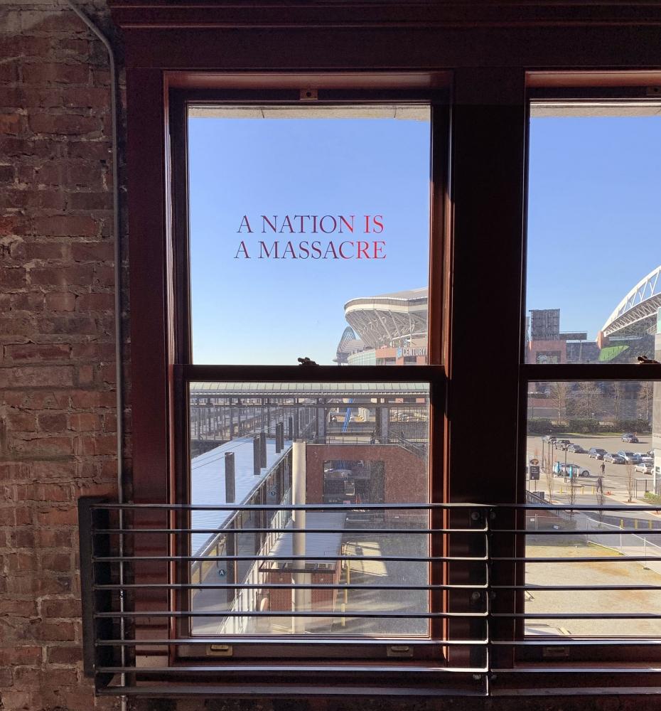 """""""A NATION IS A MASSACRE"""" by Demian DinéYazhi' (Indigenous Diné), vinyl, 2019. Photo by Otts Bolisay."""