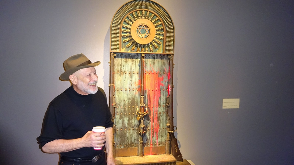 "Al Farrow in front ""Vandalized Synagogue Door."" Photo by Lisa Edge"