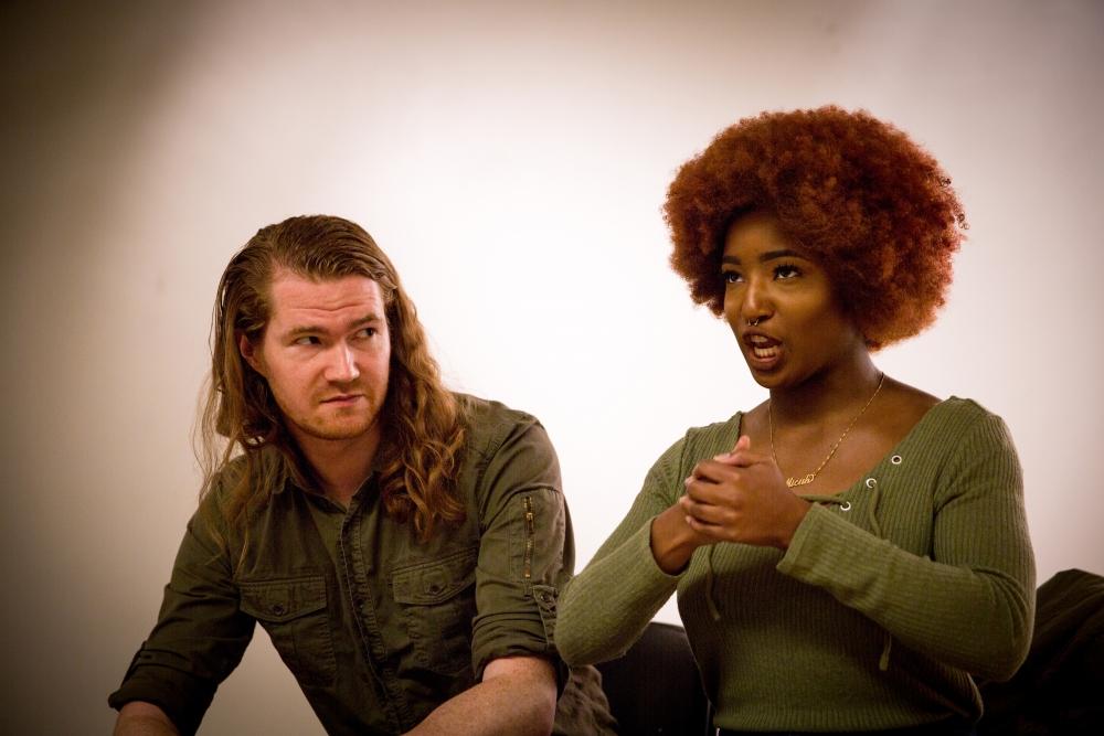From left, Paris (Robert Lovett) and Falala (Skylar Wilkerson). Rehearsal photo by Andrea Sassenrath