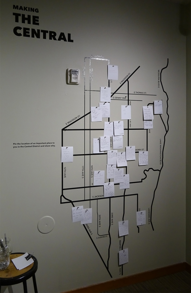 Wokoma's exhibition also includes an interactive piece. Visitors are asked to pin the location of an important place in the Central District and share why. Photo by Lisa Edge