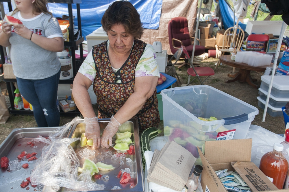 Maria Gallado prepares snacks for the men fired for protesting poor working conditions at Sarbanand Farms. Photo by Monica Westlake