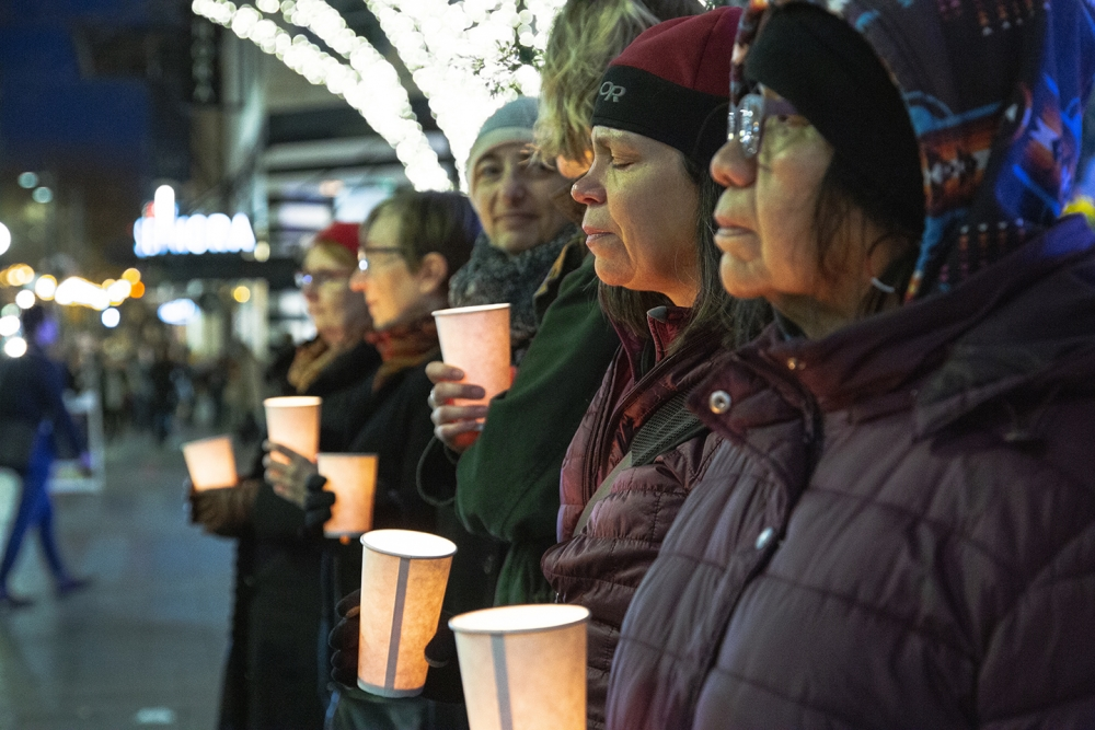 Mourners stand vigil on the longest night of the year, remembering those without shelter who have passed away on the streets in King County in 2018. Photo by Matthew S. Browning