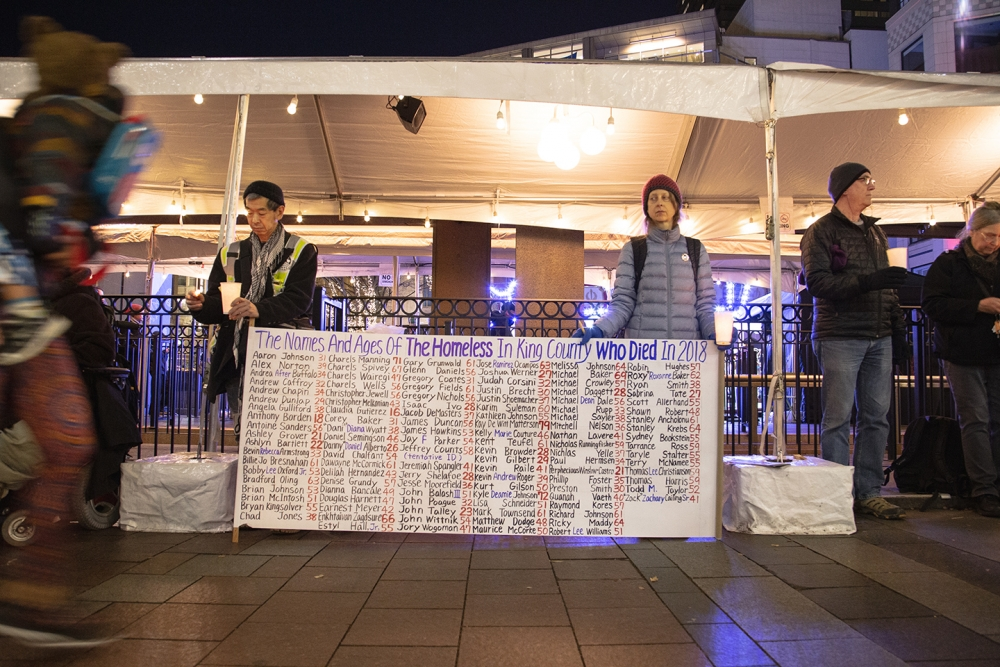The names and ages of those individuals who died outside are listed in a banner. Photo by Matthew S. Browning