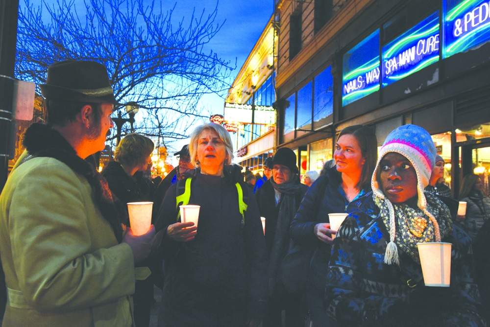 More than 50 people participated in the Women in Black Candlelight Vigil in Seattle. Photo by Valerie Franc-Houge