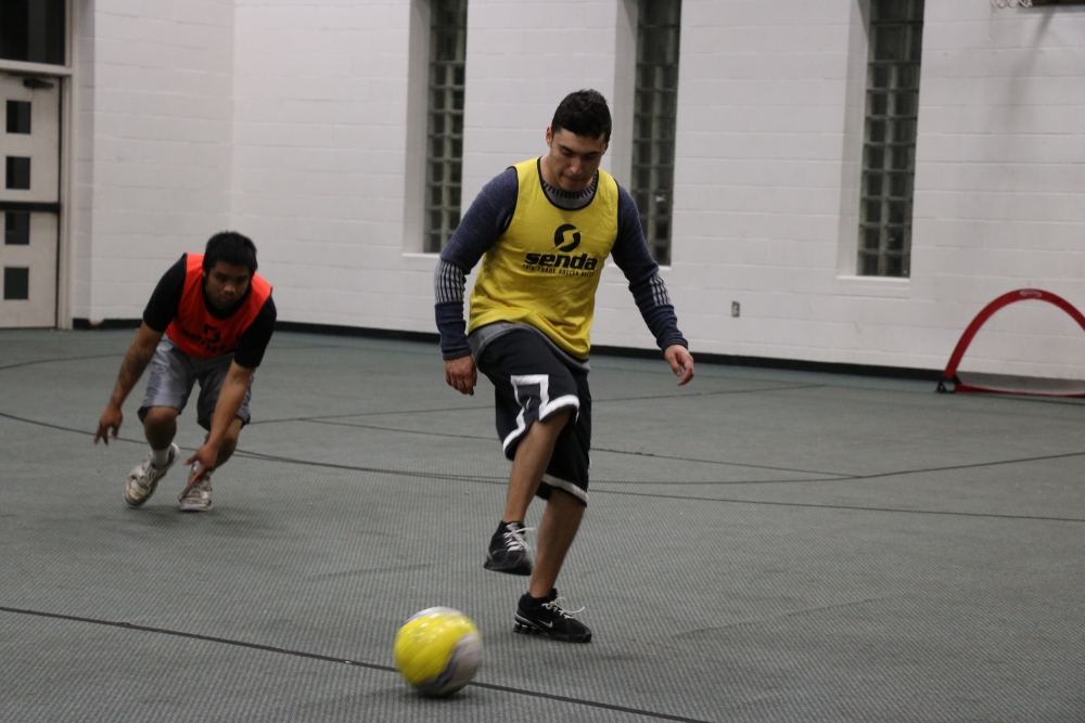 Street Soccer supports their players off the field is by pairing up players with volunteer mentors and sometimes alumni of the program. Photo by Grace Madigan