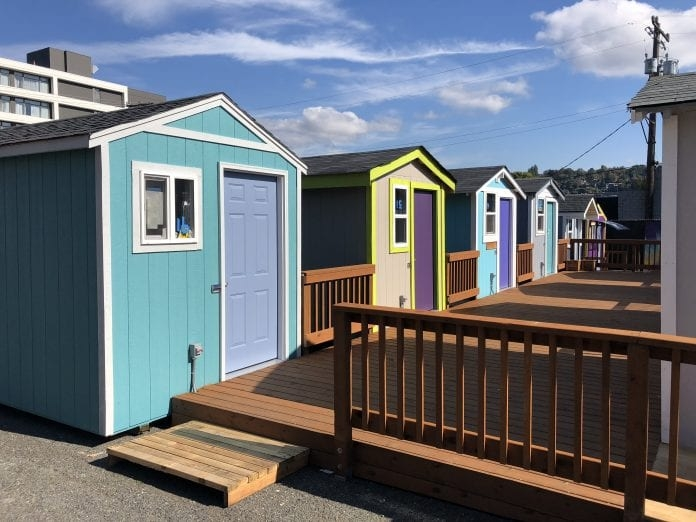Six tiny houses share a common deck in Lake Union Village. Photo courtesy of LIHI